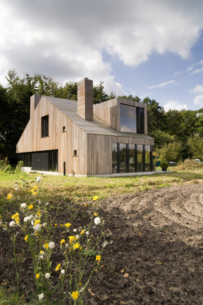 The chimney house onix archdaily - Huis architect hout ...