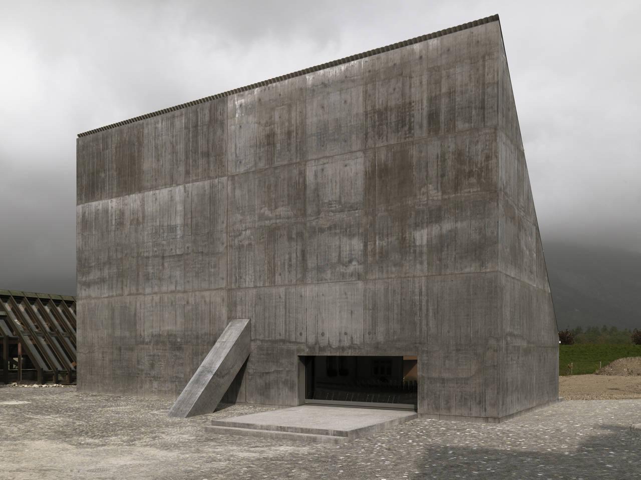Concrete Building With Windows : Plantahof auditorium archdaily