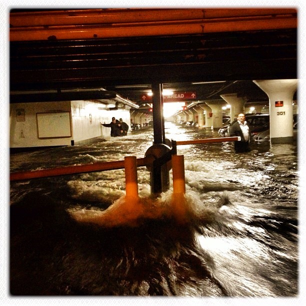 "Instagram User @time ""Water pours into a parking garage on Avenue C in Manhattan @michaelchristopherbrown #photography #photojournalism #documentary #hipstamatic #mobilephotography #streetphotography #iphoneonly #hurricanesandy #sandy #manhattan #storm #parkinggarage"""