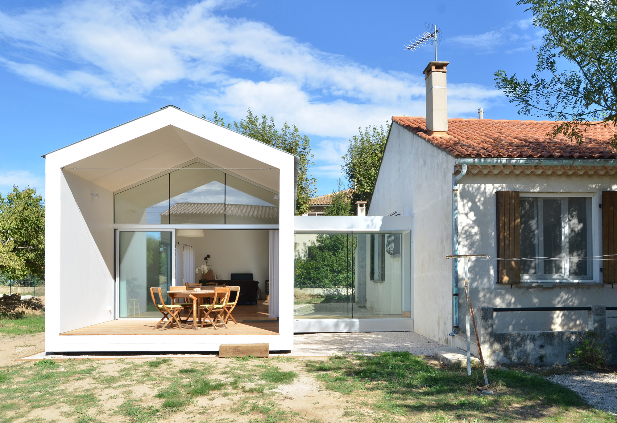 La grange de mon p re mj architectes archdaily - Extension maison container ...