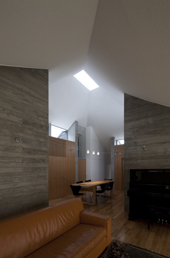 Broken Pitched Roof House / NKS Architects