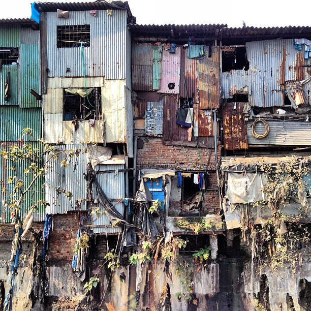 Dhravi Slum, Mumbai, India; Courtesy of Flickr User ToGa Wanderings; Licensed via <a href='https://creativecommons.org/licenses/by-sa/2.0/'>Creative Commons</a>