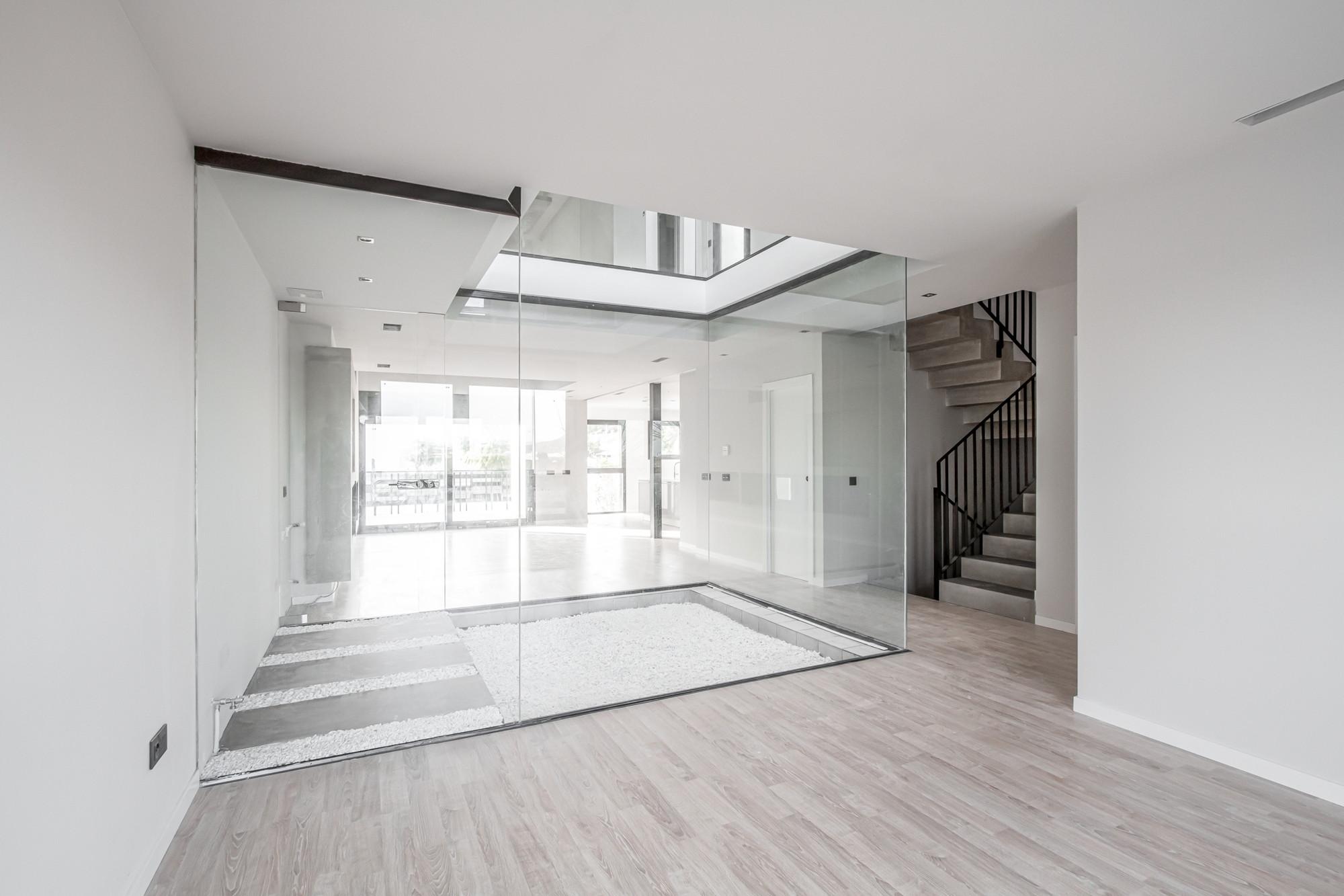 Galer\u00eda de Luz Interior, vivienda unifamiliar entre medianeras / Viraje arquitectura / - 18