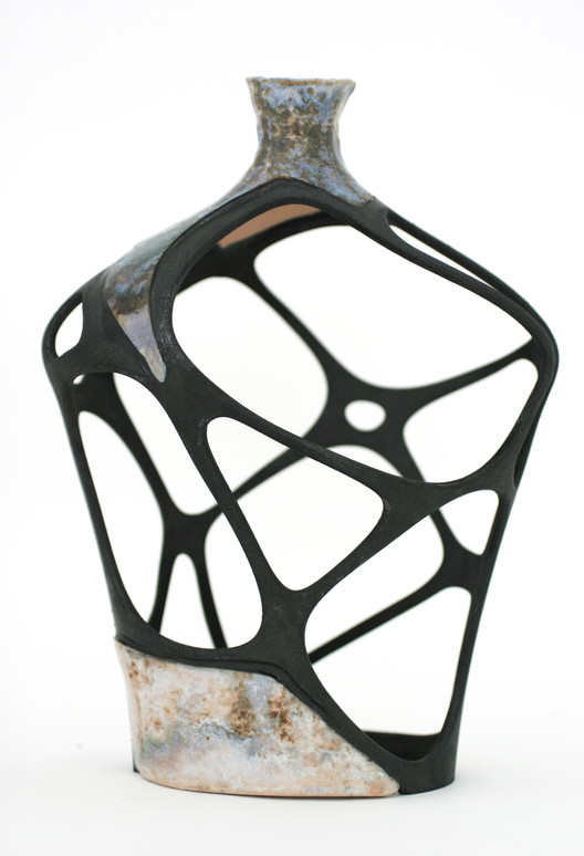 A digitally restored broken vase, glazed ceramic, SLS nylon element, epoxy glue and black spray paint, 2010. (© Amit Zoran)