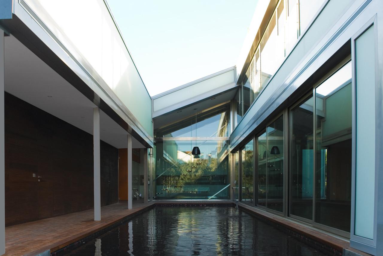 Casa en el cerro miguel barahona pyf arquitectura for Piscinas merino