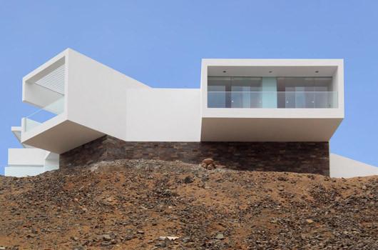 Casa i-5 / VÉRTICE Arquitectos