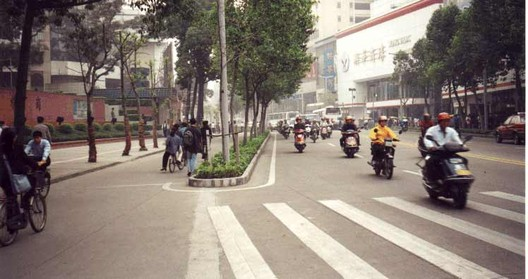 An accessible travel chain begins with safe streets and sidewalks. This street in Foshan, China, has separate rights-of-way for pedestrians, human-powered vehicles, and motor-powered vehicles