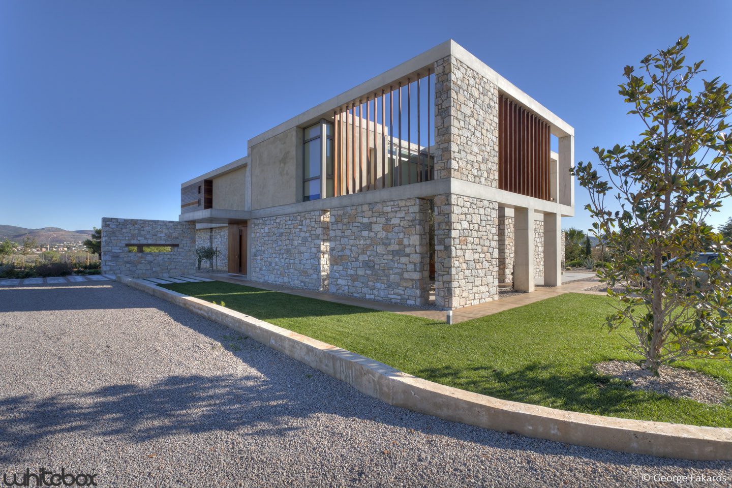 Stone house in anavissos whitebox architects archdaily for Modern stone houses architecture