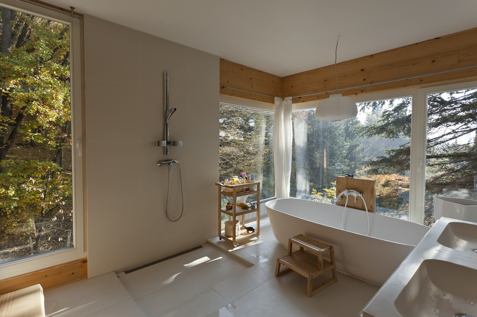 Bathroom with a view of the surrounding woods in a prefabricated timber panel house assembled in two days, Budapest, Hungary [OS] [2000×1333]