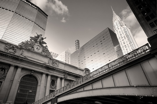 Grand Central Station (1913) in front of the MetLife (formerly Pan Am Building, 1963) and next to the Chrysler Building (1930). Image Courtesy of emin kuliyev / Shutterstock.com