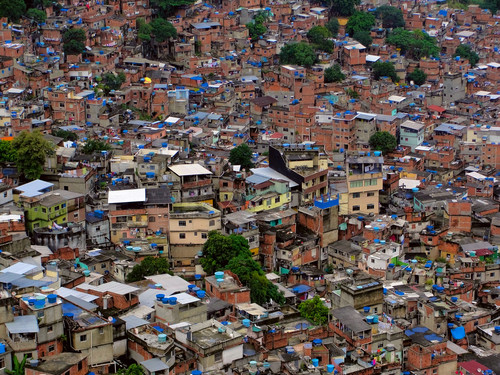 "Rocinha, a favela in Rio de Janeiro - a ""Self-generated city — disrespected by those designers who wish to impose their own will on cities, and by governments who want total control — yet representing a natural phenomenon as basic as life itself."" Image © Victoriano Junior, via shutterstock.com"