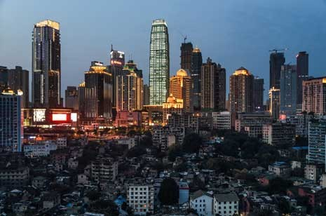China Plans to Move 250 Million into Cities by 2025, The old buildings under these high-rises in Chongqing have been marked for demolition. © Justin Jin for The New York Times