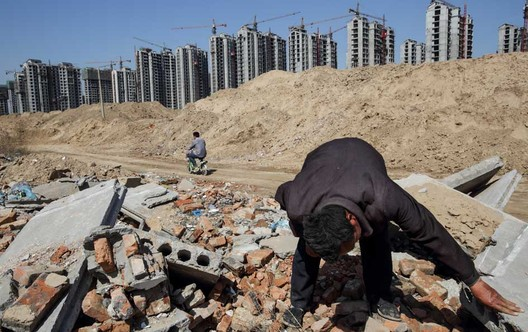 Li Rui, 60, scavenging his former village for building materials in Liaocheng. © Justin Jin for The New York Times