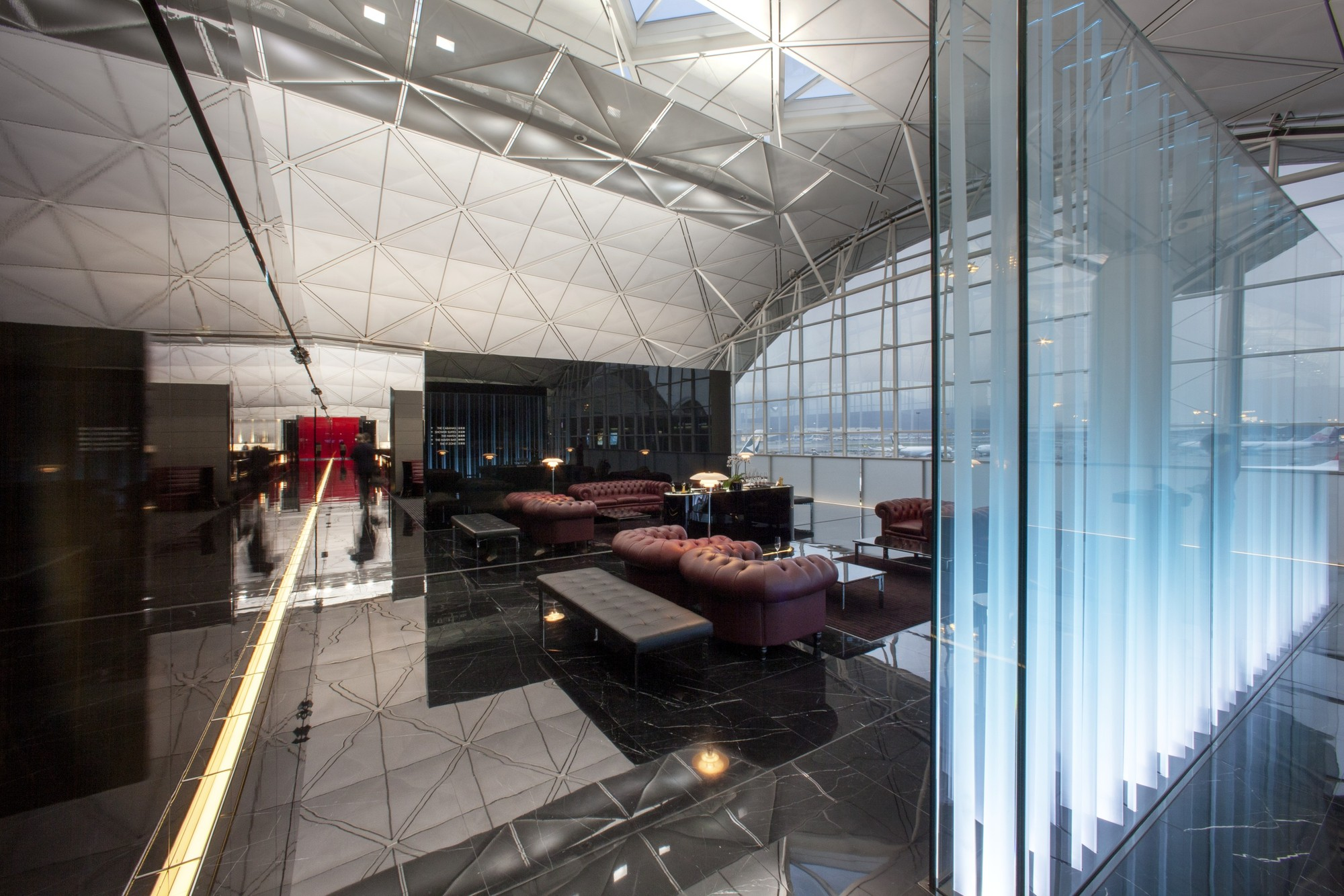 The lounges at Hong Kong International Airport, also designed by Foster + Partners. Image © John Nye