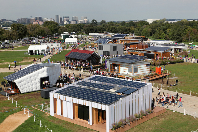 The Indicator: Why the Solar Decathlon Should Enter the Real World, Visitors tour the U.S. Department of Energy Solar Decathlon 2011 in Washington, D.C., Friday, Sept. 30, 2011, with Arlington, VA, left, and the Lincoln Memorial, right, in the background. Image © Stefano Paltera/U.S. Department of Energy Solar Decathlon