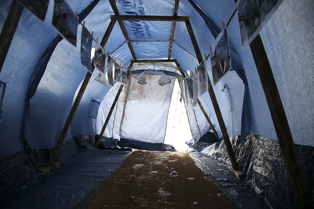 The interior of a standard issue UNHCR tent. Many families live in tents like these for years. Image Courtesy of Crossroads Foundation Photos, Flickr User Crossroad Foundation Photos