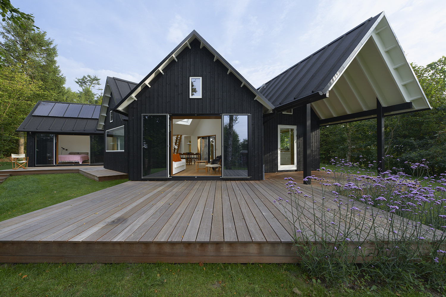 Danish summer house powerhouse company archdaily for High pitched roof house plans