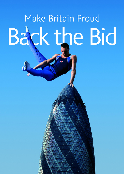 "By featuring 30 St Mary Axe as support for vaulting gymnast Ben Brown, this ""Back the Bid"" poster suggested that London possessed the expertise and daring to risk public money on hosting the Olympic Games. M&C Saatchi, Inc., ""Back the Bid,"" offset lithograph poster, 2004. Courtesy of London Organising Committee of the Olympic Games (LOCOG)."