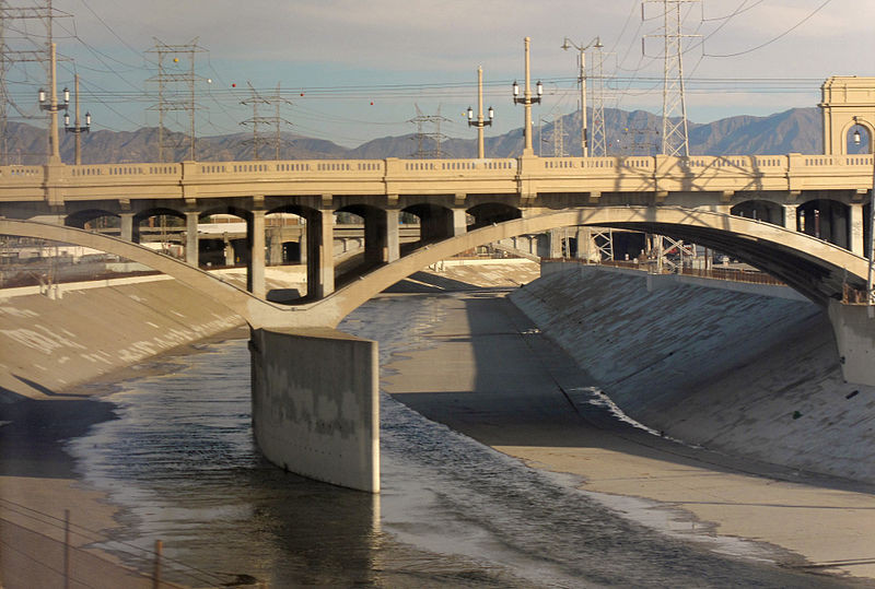 The Los Angeles River cuts a concrete path through the sprawling metropolis. Image © Wikimedia Commons