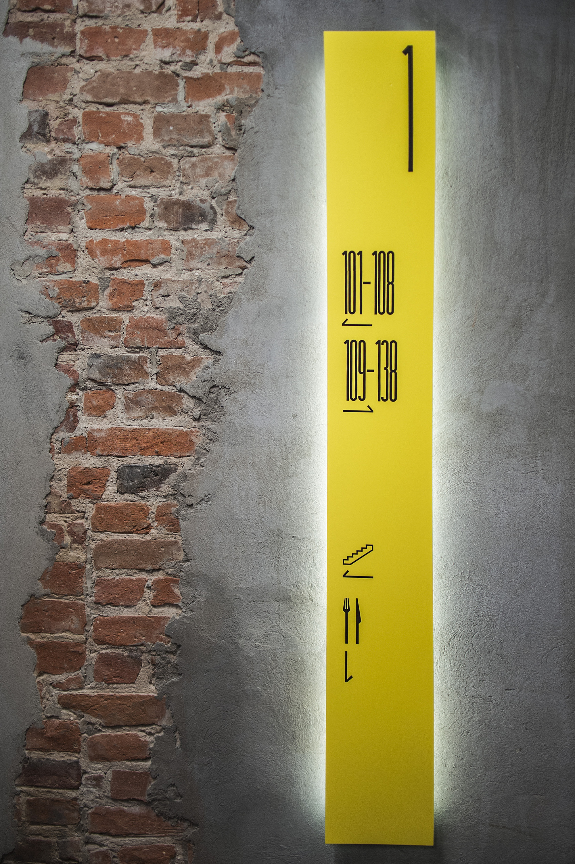 Directional Wall Painted Signage In Buildings