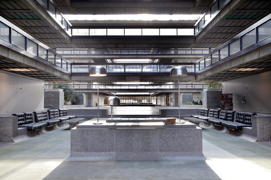 The lobby of Bell Labs in Holmdel, New Jersey, is part of a five-story, quarter-mile-long atrium. Most of the original built-ins, by Eero Saarinen, are in remarkably good shape.. Image © Rob Dobi