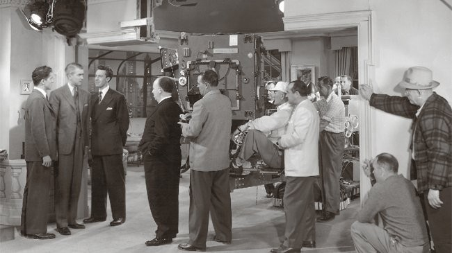 The Architecture of Alfred Hitchcock, Hitchcock on the set of Rope, with actors Jimmy Steward, John Dall, and Farley Granger. Image Courtesy of nai010 publishers