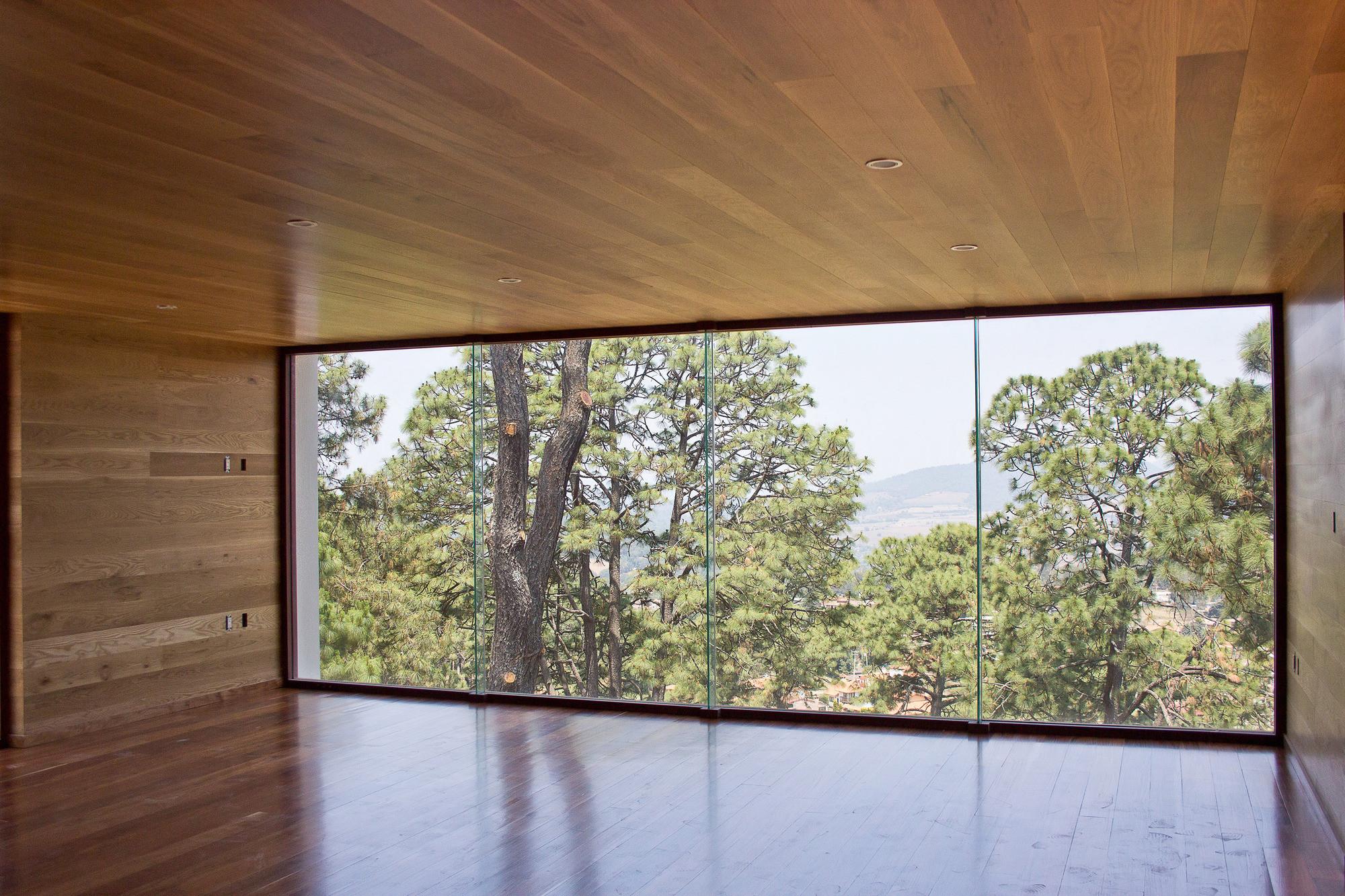 Casa en el Bosque / Espacio EMA . Image © Patricia Hernández
