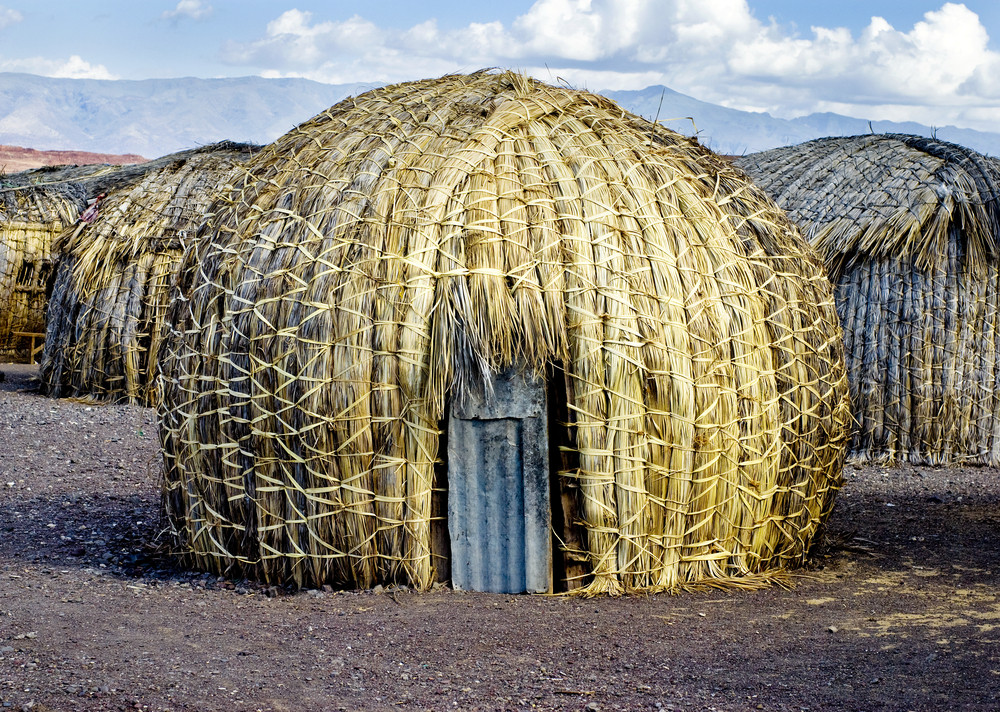 """the architectural establishment continues to ignore indigenous building cultures and the human value of what they represent. For example, traditional building and urban geometry in sub-Saharan Africa is now revealed to be essentially fractal, thus revising our customary (and totally erroneous) conception of those cultures as mathematically under-developed."" Image of El Molo Hut,  Lake Turkana, Kenya.. Image Courtesy of shutterstock.com"