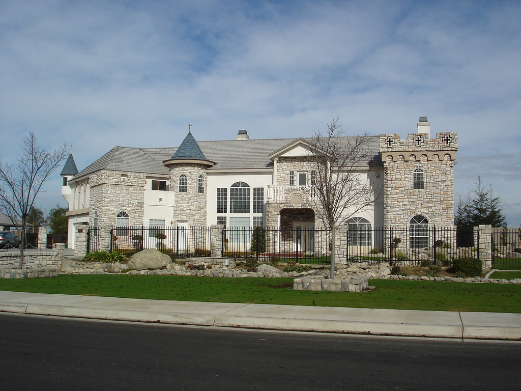 McMansions: The Ultimate Symbol of American Inequality, © Flickr CC User Doug Downen