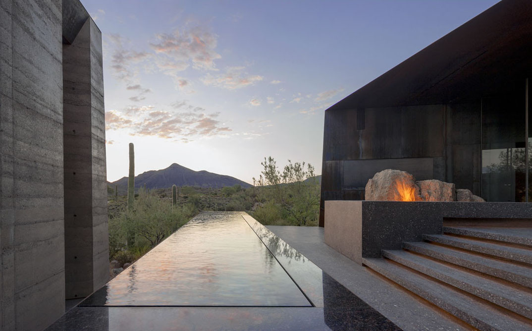 "Desert Courtyard House - Enveloping the natural landscape, the house is about ""presencing"" the desert floor and the sky within a protective, enveloping enclosure. The dwelling appears to emerge from the landscape and recede into deep shadow. Image © Bill Timmerman"