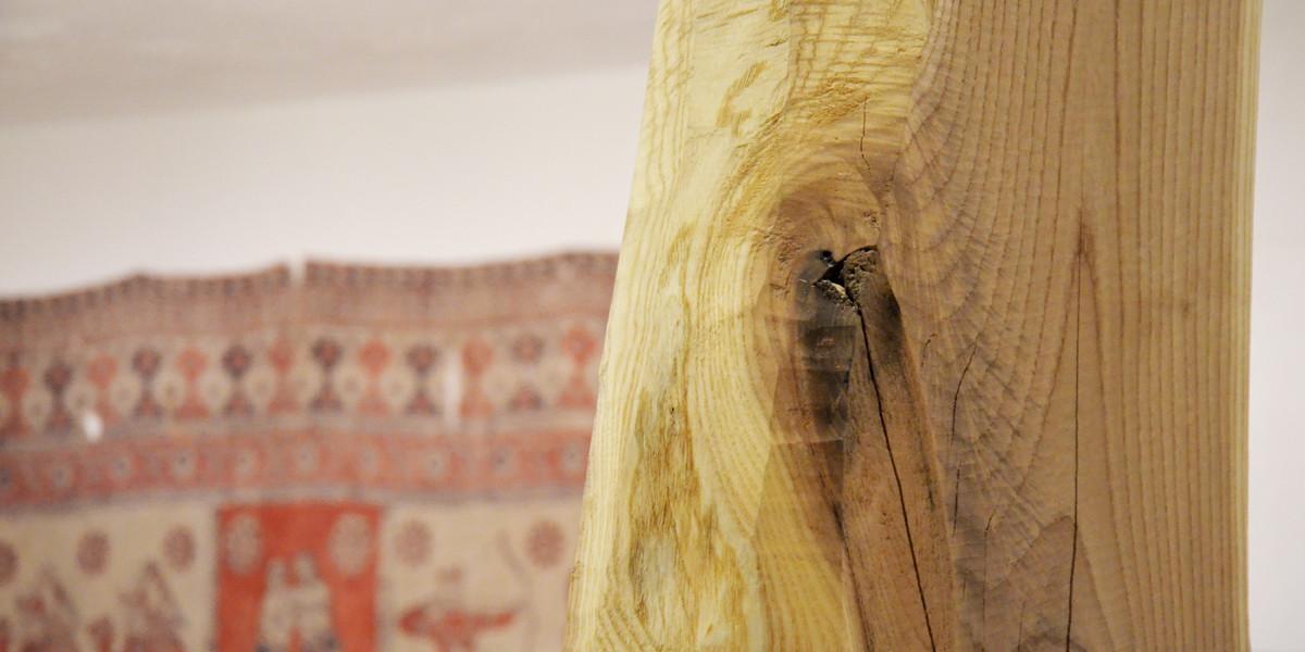 Interior detail: tree trunk (left natural) as a load bearing pillar. Image © Maria Novozhilova