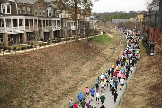 A parade passes through the Eastside Trail of the Atlanta BeltLine, completed in October 2012. Image © Christopher T. Martin