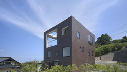 House with Square Opening / NKS Architects