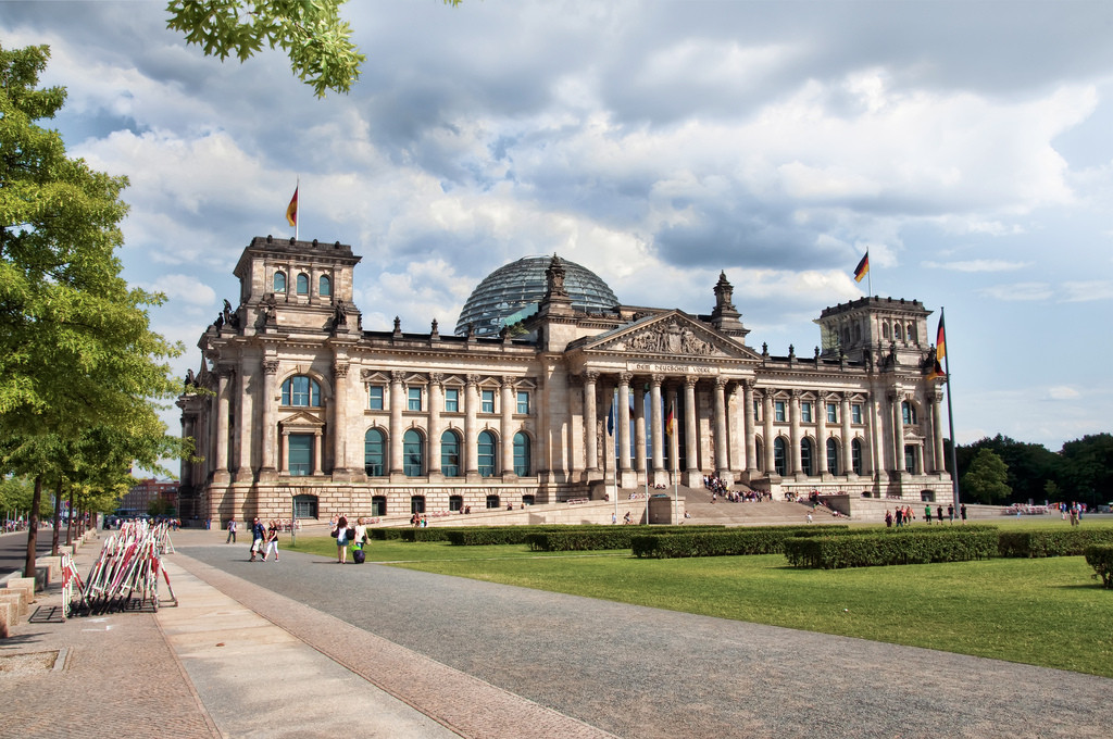 After being destroyed by fire and laying in ruins for 60 years, the Reichstag became a symbol of the new democracy in the 1990s with Norman Foster's renovation. Image © Flickr CC User Werner Kunz