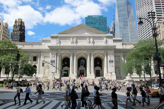 The New York Public Library's (NYPL) main building on Fifth Avenue, is a Beaux-Arts masterpiece designed by architects Carrère & Hastings. Image via Flickr User CC wallyg.