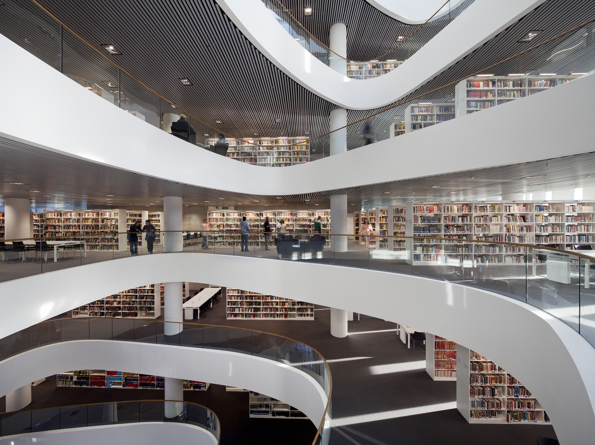 Schmidt Hammer Lassen Architects have been involved in a number of Library designs themselves, including the New Library at the University of Aberdeen. Image © Adam Mørk