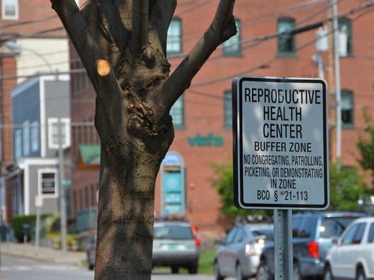A sign delineates the buffer zone outside of a Planned Parenthood in Burlington, Vermont. Image © afagen via Flickr