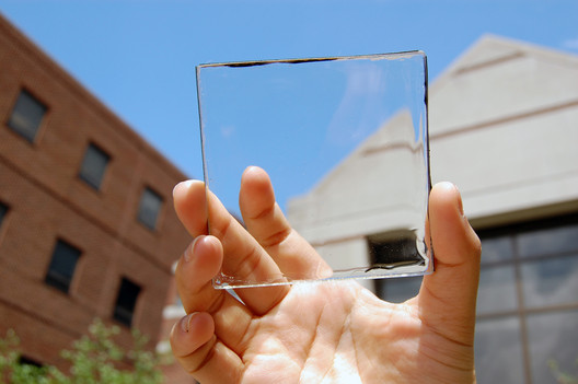 Solar power with a view: MSU doctoral student Yimu Zhao holds up a transparent luminescent solar concentrator module. Image © Yimu Zhao