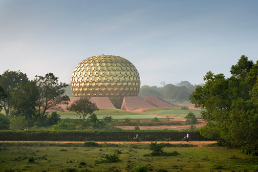 The Matrimandir in Auroville, India designed by Roger Anger and Mirra Alfassa was constructed between 1971-2008. The inner chamber contains a meditation hall which houses the largest optically perfect glass sphere in the world. Auroville is an international peace community founded as a project of the Sri Aurobindo Society in 1968 with the endorsement of the Government of India and UNESCO.. Image © James Ewing