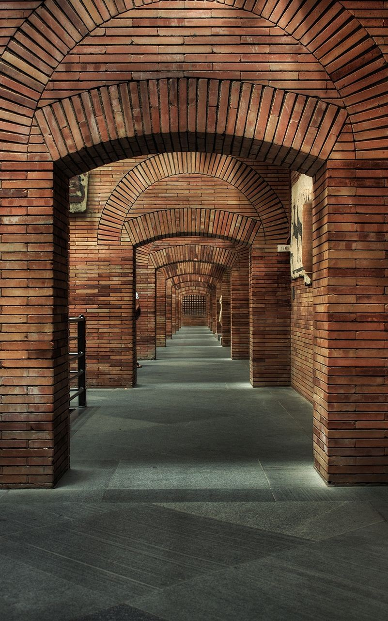 ad classics national museum of r art rafael moneo  segmented and relieving arches work in visual and structural harmony image copy flickr user guzman