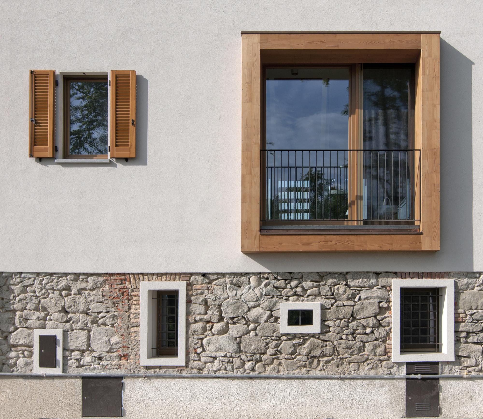 Reforma de um velho celeiro arcoquattro architettura for Case con facciate in pietra