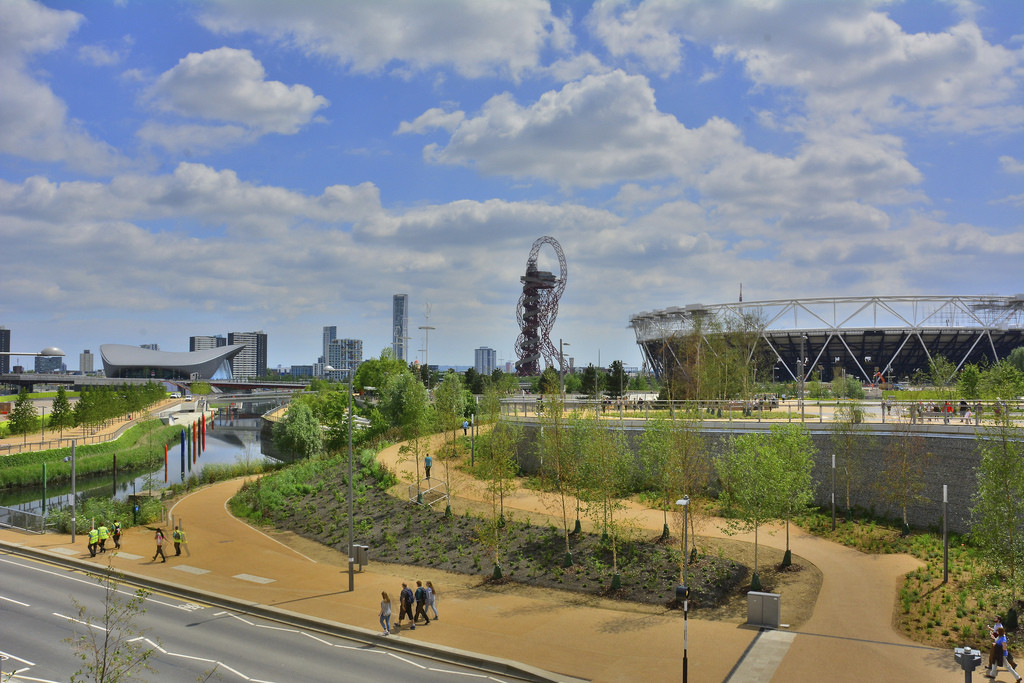 London's Queen Elizabeth Olympic Park featuring, from left to right, Zaha Hadid's Aquatics Centre, the ArcelorMittal Orbit, and the Olympic Stadium by Populous. The Olympicopolis site is on the far left. Image © Flickr CC user Martin Pettitt