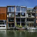The Borneo Sporenburg development in Amsterdam demonstrates a streetscape of diverse, integrated modern facades. Image © Flickr CC user Fred (bigiof)