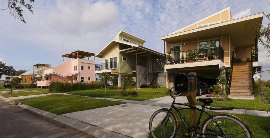 Some of the Make It Right Houses, with Steven Bingler's model at the far left. Image via makeitright.org