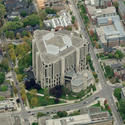 The library's triangular shape intersects violently with the rectantular street grid of the Toronto campus.. Image via Bing Maps