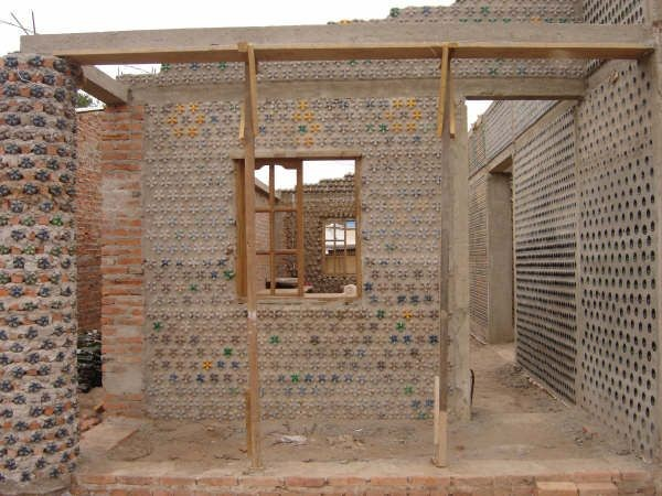 Gallery of this plastic bottle house turns trash into for House made by waste material