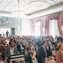 Delegates in the conference hall of the Four Seasons Ritz Hotel, Lisbon. Image © Rodrigo Cardoso