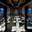 "Cannon Design Regional Offices (St Louis) / Cannon Design. Converted industrial buildings ""are big spaces vertically as well, trading the standard 9-foot (3-meter) ceiling in most office towers for soaring rafters"". Image © Architectural Imageworks, LLC"