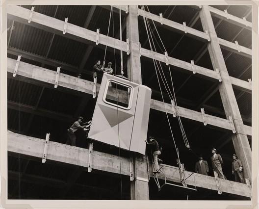 Newman-Schmidt Studios, Workmen installing the first aluminum panel, 1951. Gelatin silver print. Director's Discretionary Fund.