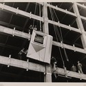 HAC Lab Pittsburgh: Imagining the Modern Newman-Schmidt Studios, Workmen installing the first aluminum panel, 1951. Gelatin silver print. Director's Discretionary Fund.